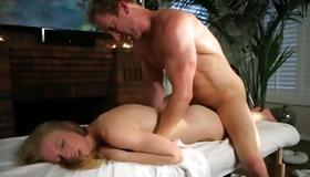 Blonde girl on massage bed hammered deep