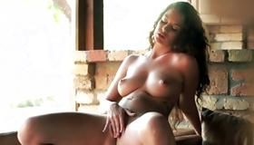 Fascinating slut is sexy rubbing her breasts