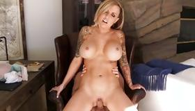 Tattooed lusty whore is riding on heavy dong