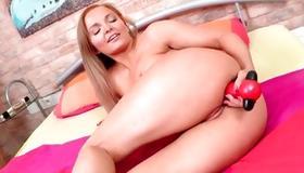Passionate blonde slut self fucking her with dildo